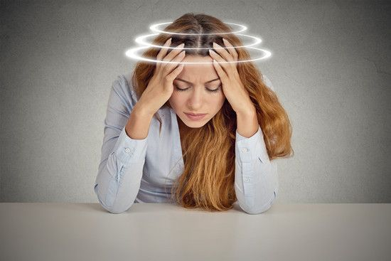 A woman is suffering from Dizziness during work