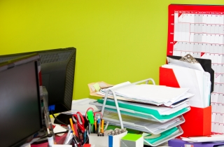 An Office Desk with a Lot of Clutter