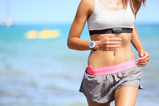 Runner woman running with heart rate monitor