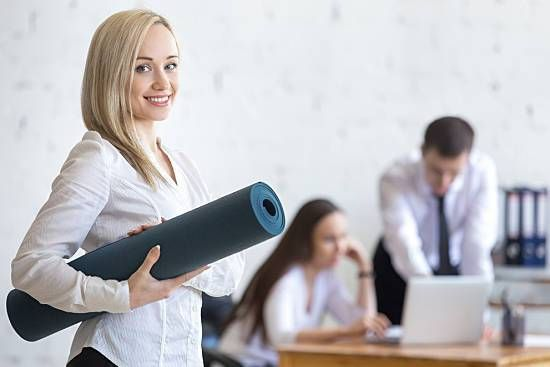Young woman preparing to exercise at work