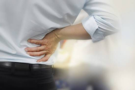 Worker with chronic back pain.