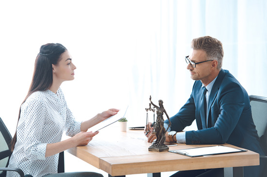 A woman is asking her consultant something