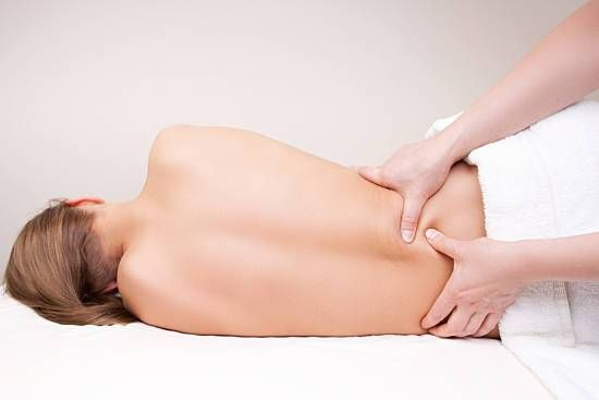 Woman receiving a lower back massage