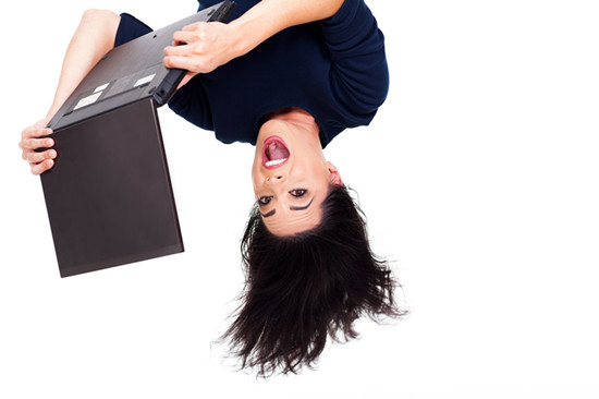 A woman is hanging upside down