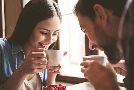 A couple enjoys delicious cups of coffee.