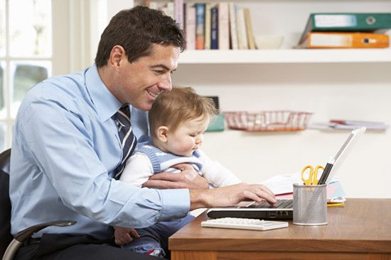 A man is working at home with his kid