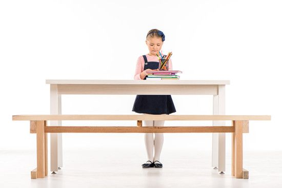 a kid at standing desk