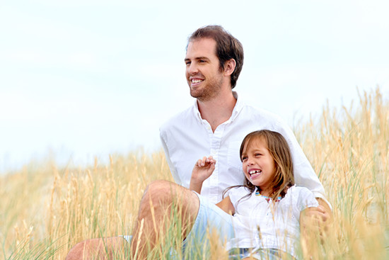 A father is enjoying life with his daughter