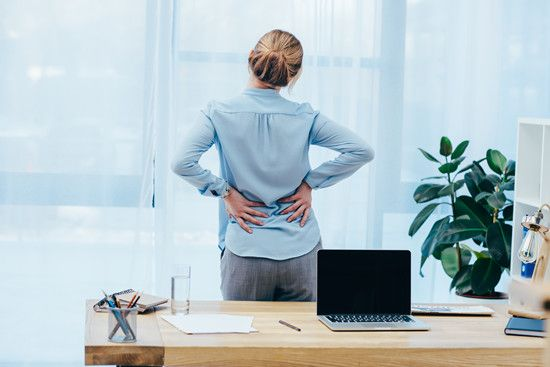 An employee feels low back pain