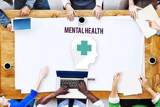 Abstract image of a group of employees discussing mental health in the workplace