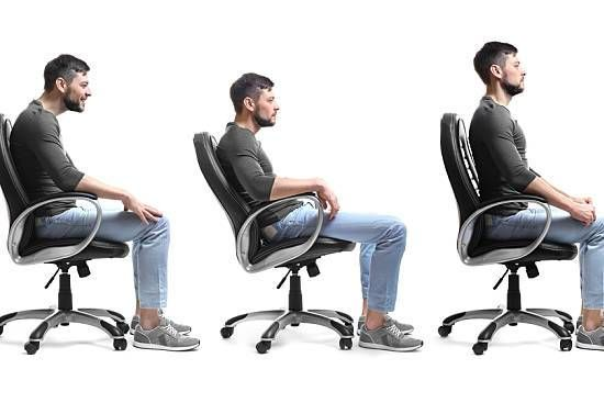 Man practicing good posture at his desk chair