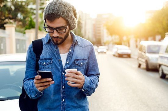 A young man is texting on his phone