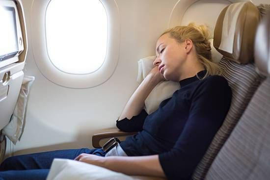 Woman sleeps on plane while flying