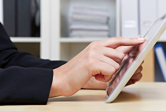 Person using an app on a tablet