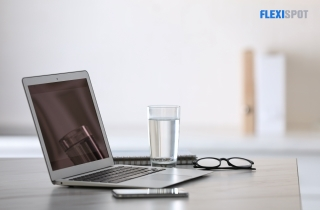 Glass of Water by the Laptop