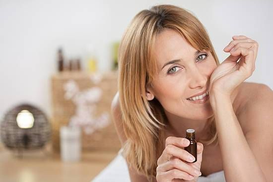 Woman smells essential oils on her arm