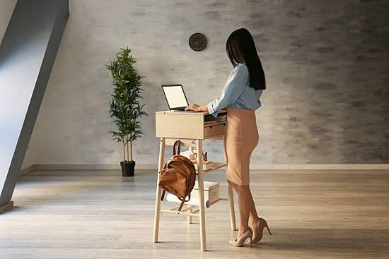 A woman stands while she works