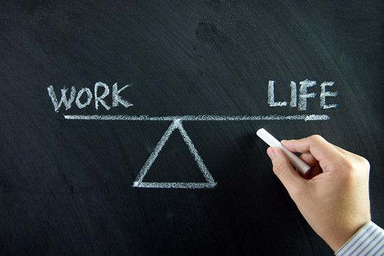 A man is writing about the balance between work and life