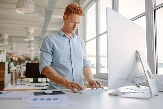 A standing desk can help your employees work smarter.