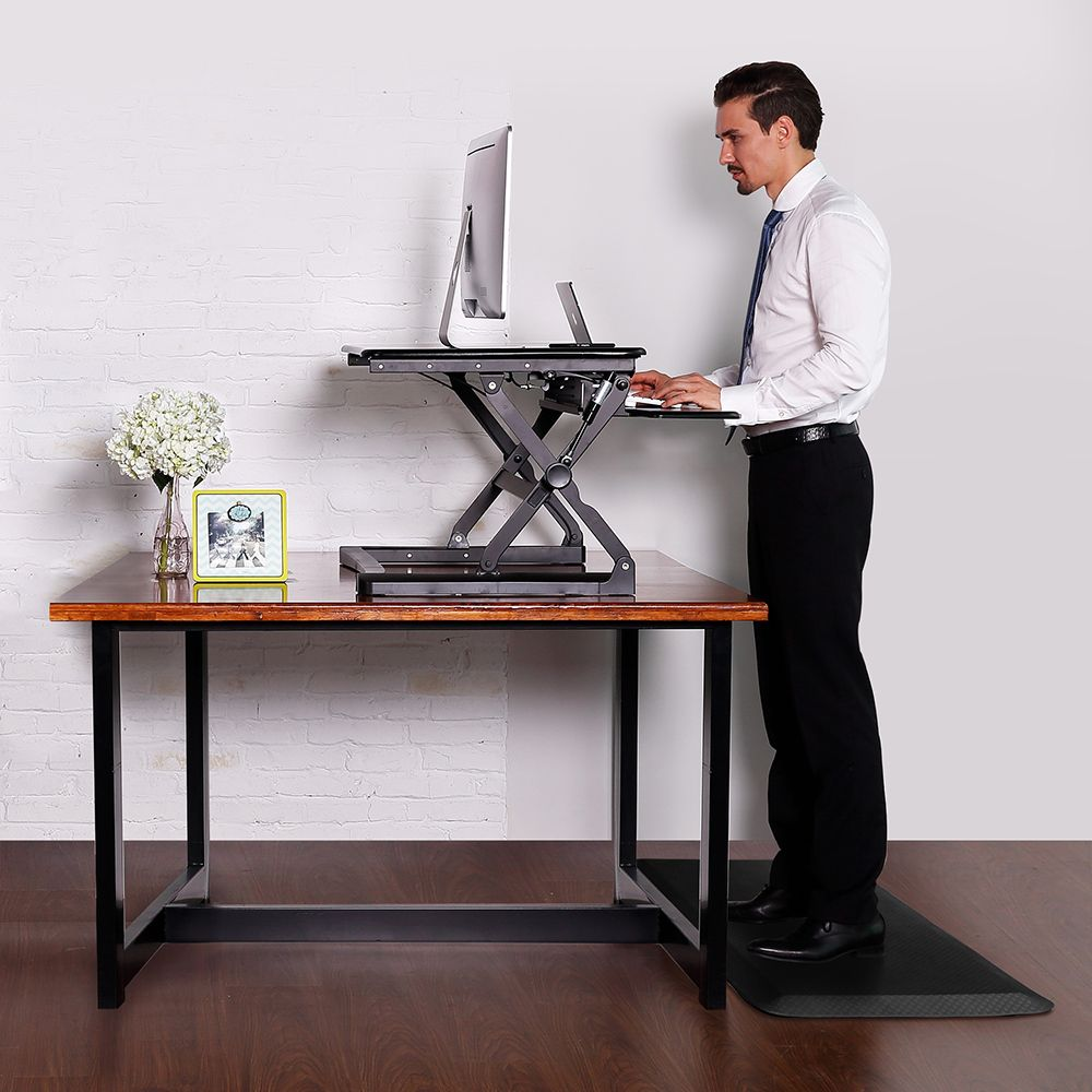 how to stand at standing desk